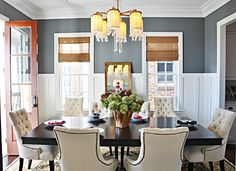 Another great wall color for the dining room, this blue is not as dramatic as the navy. I like the bamboo blinds with it too.