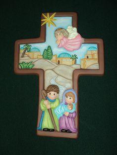 La sagrada familia en una cruz - ceramica