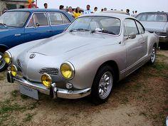 silver volkswagen karmann ghia custom with yellow headlight lenses