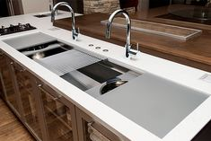 The Galley Ideal Workstation 7 oversized stainless steel kitchen sink.