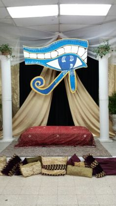 Outside display idea, black backing, gold border, gold curtains, eye in the middle Diy Egyptian Decorations, Halloween Decorations, Gold Curtains, Diy Curtains, Egyptian Themed Party, Ancient Egypt For Kids, Egyptian Drawings, Egyptian Crafts, Egyptian Costume