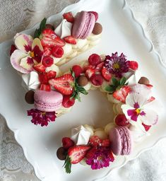 #almond #cookiecake #berries #macarons #edibleflowers #chocolatecoveredhazelnuts