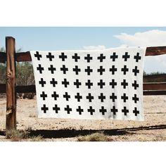 (http://www.spearmintlove.com/eco-cross-baby-blanket-cream-black/)