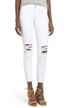 Enjoying the classic look of five-pocket denim with these soft and stretchy ankle-cropped leggings in a crisp white color.