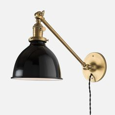 Timeless task lighting for any room in the house. An adjustable arm lets you shine light where you need it.  Our exclusive parts are made of heavy gauge, solid American brass and hand-finished in our state-of-the-art patina shop. Once parts are finished, our craftspeople in Portland, Oregon, build each fixture to your specifications. Price is fixture only, does not include shade.   Arm length: 12