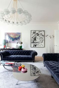 Navy sofa and mirrored table