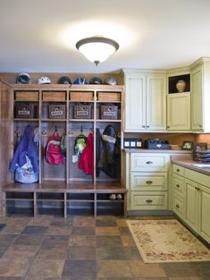 Love the Bulit-ins for Kiddos!  traditional laundry room by Knight Construction Design | Chanhassen, Minnesota
