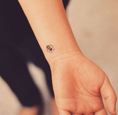 Tiny Bumble Bee Tattoo on Wrist by Grain