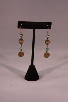 Bronze acorn and green bead dangle earrings. Mountain Laurel Boutique