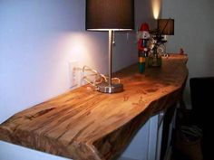 Live Edge Wood Mantel Modern - Inspiration for fireplace mantel. Wanting a local source {{ignore the awkward nut cracker}} Wood, Wood Mantle, Shelves, Wood Slab, Wood Fireplace, Wood Shelves, Wood Mantels, Wood Table, Live Edge Furniture