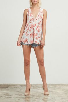 V-neck tank with a flirty floral print, and a racer back. Pair with your favorite shorts and some strappy sandals for an effortlessly adorable Summer look!   Floral V-Neck Tank by Cupcakes & Cashmere. Clothing - Tops - Tees & Tanks Clothing - Tops - Sleeveless Texas