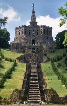 Wilhelmshöhe Castle (formerly Karlsberg) was built in 1696. It occupies an entire hillside in the city of Kassel, Germany. The crown of the hill is the gigantic 'grotto' topped by the sculpture of Hercules, situated almost 300 m. above the foot of the garden.