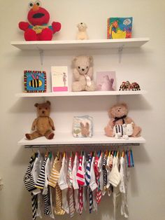 I like that the bottom shelf has a clothes hanger rod attached to it...maybe use the rod to hang shoes by hooks instead of outfits?