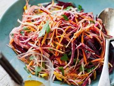Beet, Carrot & Apple Salad - This gorgeous, colorful slaw bursts with good-for-you ingredients, and weighs in at a mere 118 calories per serving. When prepping beets, wear disposable gloves and an apron to prevent beet juice from staining your fingers and Raw Food Recipes, Salad Recipes, Vegetarian Recipes, Cooking Recipes, Healthy Recipes, Cooking Tips, Apple Salad, Beet Salad, Raw Beetroot Salad