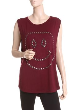 Smile-face studded top.  This top goes with leggings, cute vintage boots, and nice warm knit hat!  Very cute!
