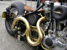 really amazing Harley vtwin custom exhaust with some kind of gold coating