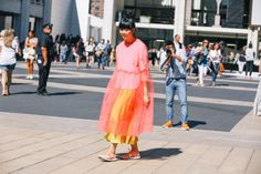 Blooming Susie Bubble makes a neon statement in an oversize coral pink chiffon dress and citrus hues.