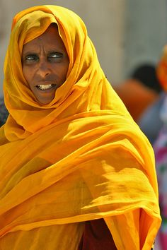 Eritrean woman, yellow, by Eric Lafforgue