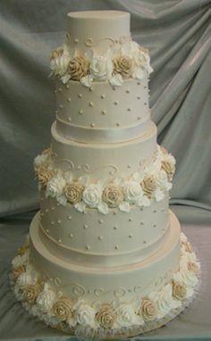 Ivory Ercream Wedding Cake With White And Roses
