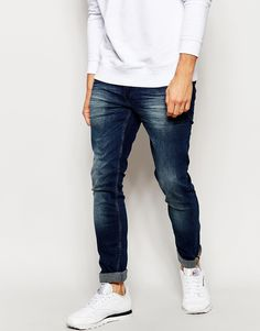 "Skinny jeans by Blend Stretch denim Dark wash Low rise Zip fly 3D whisker detailing Fading through the leg Skinny fit - cut closely to the body Machine wash 98% Cotton, 2% Elastane Our model wears a 32""/81 cm regular and is 185.5cm/6'1"" tall"