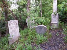 A few tombstones outside the queue at Haunted Mansion, Orlando.  Photo by John Eagen