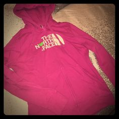 North Face Hoodie A pink North Face hoodie, warn a few times in great condition. Very comfortable! Logo on the front of the hoodie. North Face Tops Sweatshirts & Hoodies