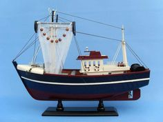 NOT A MODEL SHIP KIT Attach Sails and this Model Fishing Boat is Ready for Immediate Display Prepare to harvest the fruit of the sea with this adorable fishing boat model. Whether your catch is fish,