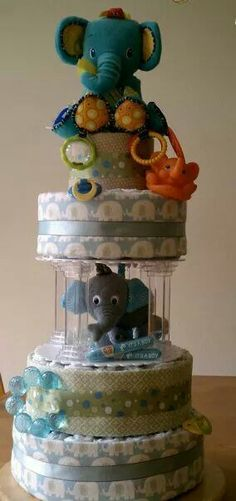I made this 4 tier elephant themed diaper cake with pillars