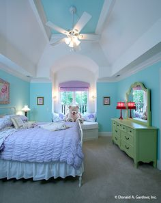 Girl's bedroom with a vaulted ceiling, green dresser, white metal bed, and an alcove window seat topped with charming pillows and a cute teddy bear. Ranch House Plans, New House Plans, Dream House Plans, House Floor Plans, White Metal Bed, Home Builders Association, European Style Homes, Bedroom Photos, Little Girl Rooms