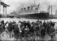 A crowd admires the Cunard-White Star Line passenger ship the RMS Queen Mary at Clydebank, near Glasgow, in Scotland in 1936