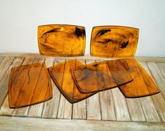 30 set of tortoise shell trays. In great vintage condition, normal wear due to age and use. There are misc. markings and scrapes, no chips or cracks, please see pictures. The trays may be plastic or a hard resin, Im not sure though. A beautiful set of trays to use for snacks or a party. This listing is for 6 trays. Measures 7 1/4 Long X 5 1/4 Wide.