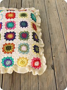 TraceyNicole's granny square pillow with ruffled edging at Ravelry