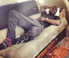 This is how Kevin Hart relaxes. Peep the socks.