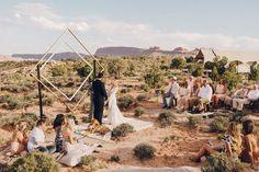Desert Ceremony with diamond arch in Moab, UT, festival wedding in the desert. Wedding planner for Adventurous COuples