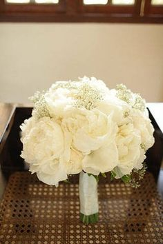white peonies and baby's breath.  This is pretty much my dream bouquet.  Just make the peonies blush and we're good to go.