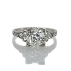 """Art Deco Engagement Ring, $14,950  beautiful Old European Cut Diamond weighing 1.99 cts and assessed by the UGL appraisal service as L color and VS2 clarity is set in a """"picture frame"""" cornered head and accented with six diamonds in the stepped shoulders. The prongs and sides are beautifully engraved. A vintage original from the early 20th century. Platinum."""
