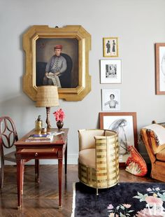 A late-19th-century family portrait gazes down on a Louis XVI desk and an early Thonet wood chair in the television room of fashion designer Stefano Pilati's Paris duplex; the other artwork includes a Robert Doisneau photograph of Pablo Picasso and a Juergen Teller image of model Kristen McMenamy.  ARCHITECT: Bruno Caron Architectes PHOTOGRAPHER: Björn Wallander