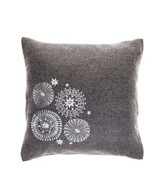 Mod Medallion wool-and-alpaca pillow with feather-and-down fill (16 inches square), $195, ochrestore.com.