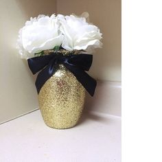 """This set of 3 vases is perfect for weddings, anniversaries, graduations, and other events! You will receive a set of 3 Beautiful Glittering Glass 7"""" Jardin Vases with a Black Ribbon tied around the va"""