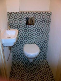 Wall hung toilet  beautiful tiled back wall