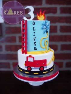 Both tiers iced in buttercream. Marshmallow Fondant flames, ladder, fire truck, hose, water and number topper. Big Cakes, Cute Cakes, Marshmallow Fondant, Fireman Sam Cake, Fireman Party, Fire Engine Cake, Fire Fighter Cake, Firefighter Birthday, Truck Cakes