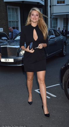 Good neighbour: Holly Valance put on a bust display as she sported a LBD with a keyhole feature for the well-heeled bash