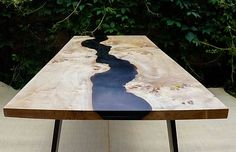 Black river table with epoxy inlay