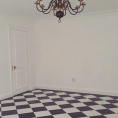 Checkerboard floors and white walls. Room make-over.