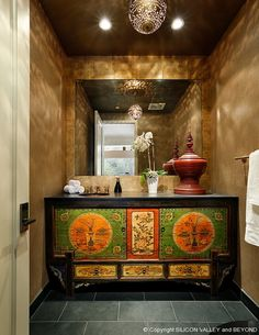 18th Century Tibetan cabinet in this gorgeous powder room.  See more at www.MyZenRetreat.com