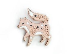 A beautiful hard enamel pin badge featuring a gorgeous floral fox. Simple and elegant, this is the perfect brooch for the foxy person in your life! It would be a fabulous addition to any outfit, or even a growing pin badge collection! - Rose gold finish - 2.2cm x 2.7cm in size - Black,