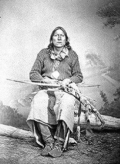 Native American National Archive White Bear (Sa-tan-ta), a Kiowa chief; full-length, seated, holding bow and arrows. Photographed by William S. Soule, 1869-74. American Indian Select List number 130.