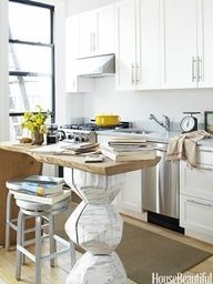 Kitchen of the Month, July/August 2012. Design: Fitzhugh Karol and Lyndsay Caleo. Photo: Tara Striano. housebeautiful.com. #kitchen #small_kitchen #studio_apartment #wood_island #hand_carved_wood
