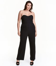 Check this out! Strapless jumpsuit in woven stretch fabric. Bandeau bodice with boning at sides and silicone trim inside upper edge. Cut-out section and elastication at back, concealed zip at side, and wide legs. - Visit hm.com to see more.