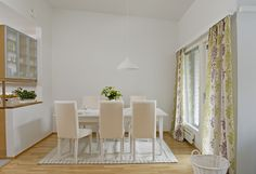 The #white walls and #cream furniture makes the #green center piece and #curtains pop! A fab way to create a focal point